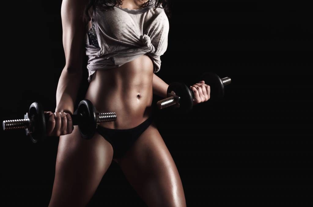 Sports & Fitness - Woman with abdominal muscles - Garage