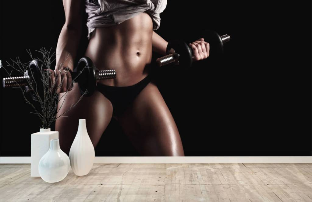 Sports & Fitness - Woman with abdominal muscles - Garage 7